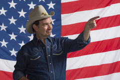 Patriotic cowboy pointing up, horizontal Stock Photos