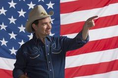 Patriotic cowboy pointing up, horizontal Stock Photos