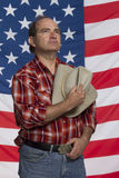 Patriotic cowboy taking off hat, horizontal Royalty Free Stock Photography