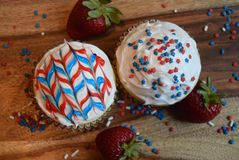 Patriotic cupcakes for July 4th celebration. Colorful patriotic decorated cupcakes for summer celebration.  American flag themed cupcakes Royalty Free Stock Image