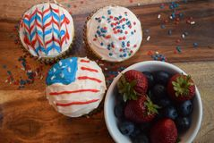 Patriotic cupcakes for July 4th celebration. Colorful patriotic decorated cupcakes for summer celebration.  American flag themed cupcakes Stock Photos