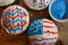Patriotic cupcakes for July 4th celebration. Colorful patriotic decorated cupcakes for summer celebration.  American flag themed cupcakes Royalty Free Stock Photos