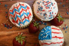 Patriotic cupcakes for July 4th celebration. Colorful patriotic decorated cupcakes for summer celebration.  American flag themed cupcakes Stock Images