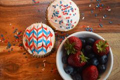 Patriotic cupcakes for July 4th celebration. Colorful patriotic decorated cupcakes for summer celebration.  American flag themed cupcakes Stock Photo