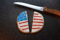 Divided Patriotic cookies. Patriotic decorated cookies divided. America divided by political turmoil. Political divisions Stock Image