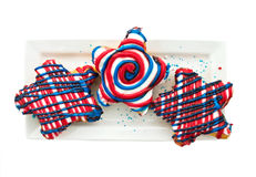 Patriotic desserts. Patriotic doughnuts isolated on white with shallow DOF and clipping path Stock Photos