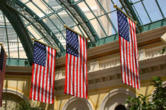 Patriotic Display. American flags are draped from the inside of Bellagio Hotel's conservatory in Las Vegas, Nevada Stock Images