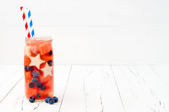Patriotic drink cocktail with watermelon, blueberry and apple for 4th of July party. Fruit infused water Stock Image