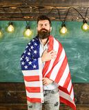 Patriotic education concept. American teacher covered with american flag. Teacher teaches to love homeland, USA. Man Royalty Free Stock Photography