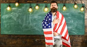 Patriotic education concept. Teacher teaches to love homeland, USA. Man with beard and mustache on serious face with Stock Image