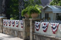 Rock and Picket Fence with Flag Banners Royalty Free Stock Photography