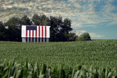 Patriotic flag barn. This corn farmer painted his entire barn with a flag motif stock images