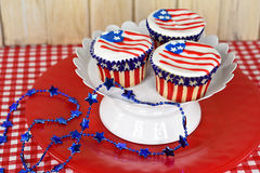 Patriotic flag cupcakes on pedestal Royalty Free Stock Photography