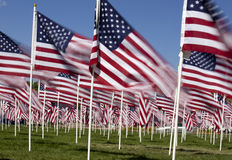Patriotic Flag Display. With a long exposure for blur effect on flag motion Stock Photo