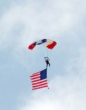 Patriotic flag and parachute Stock Image