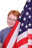 Patriotic girl. Portrait of a young girl posing with an american flag Royalty Free Stock Photography