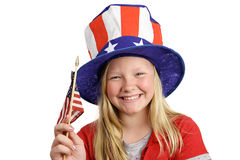 Patriotic Girl. A pretty little girl in a patriotic hat waving an American flag.  Isolated on white Royalty Free Stock Photo