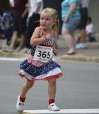 Patriotic Girl Runs in Race Stock Image