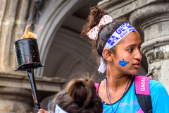 Patriotic girl with torch, Independence Day, Antigua, Guatemala. Antigua, Guatemala - September 14, 2015: Patriotic girl with torch & Guatemala headband & face Stock Images