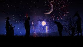 Patriotic Golf. This video features the silhouette of golfers playing the game against a deep blue sky with fireworks exploding in the distance stock footage