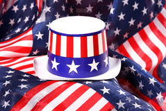 Patriotic Hat. Patriotic colored hat on flag printed fabric. Great for Memorial Day, 4th of July or political events stock images