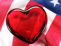 Patriotic heart. Glass heart on American USA flag red white and blue Stock Photos