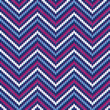 Patriotic Herringbone. Chevron pattern in red, white and blue repeats seamlessly Royalty Free Stock Image