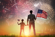 Patriotic holiday. Happy family. Patriotic holiday. Happy kid, cute little child girl and her father with American flag. USA celebrate 4th of July royalty free stock image