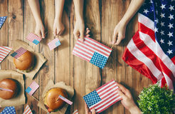 Patriotic holiday. Happy family. Patriotic holiday. Mother, father and child are doing burgers. Happy family are celebrate 4th of July. Top view with American stock photos