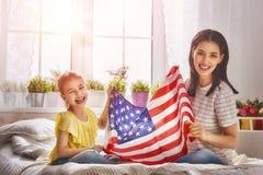 Patriotic holiday and happy family Stock Photos