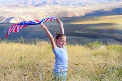 Patriotic holiday. Happy kid, cute little child girl with American flag. National 4 july. Memorial day. stock photo