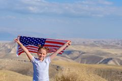 Patriotic holiday. Happy kid, cute little child girl with American flag. National 4 july. Memorial day. royalty free stock photo