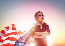 Patriotic holiday and happy kid Stock Photos