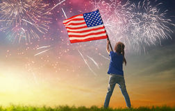 Patriotic holiday. Happy kid. Cute little child girl with American flag. USA celebrate 4th of July Royalty Free Stock Image