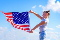 Patriotic holiday. Happy kid, cute little child girl with American flag. USA celebrate 4th of July. stock image