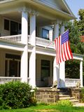 Patriotic Home. A beautiful colonial home shows its patriotic side Stock Photos