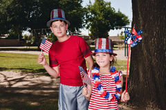 Patriotic Kids. Two kids, brother and sister, holding their American flags being Patriotic Stock Photos