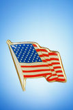 Patriotic Lapel Pin. Golden American Flag lapel pin against a blue gradient background royalty free stock photography