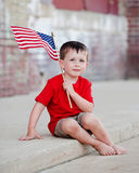 Patriotic Little Boy on Curb Royalty Free Stock Image