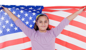 Patriotic little girl with american flag. Isolated over white Stock Photo