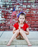 Patriotic Little Girl on Curb Royalty Free Stock Photo