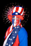 Patriotic man and fireworks Stock Photos
