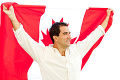 Patriotic man holding Canada flag Royalty Free Stock Photography