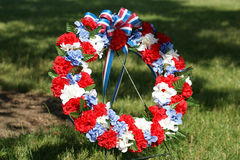 Patriotic Memorial Wreath Centered. Centered view of memorial wreath of flowers decorated in the colors of the American flag stock images
