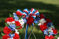 Patriotic Memorial Wreath Close Up. Close view of top of memorial wreath of flowers decorated in the colors of the American flag royalty free stock photography