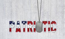 Patriotic military dog tags on wood Royalty Free Stock Photos