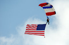 Patriotic person jumps out of a plane Royalty Free Stock Images
