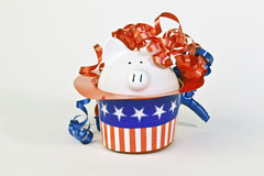 Patriotic piggy bank in a stars and stripes hat Stock Photography