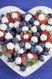 Patriotic red, white and blue berries with fresh whipped cream stars - vertical close up. Royalty Free Stock Photo