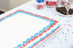 Patriotic red, white and blue cake with champagne royalty free stock image